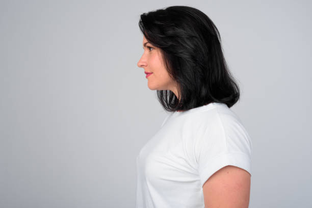 Profile view of beautiful woman with short hair against white background stock photo