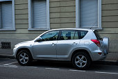 istock Profile view of grey Toyota rav4 crossover  parked in the street 1280124296