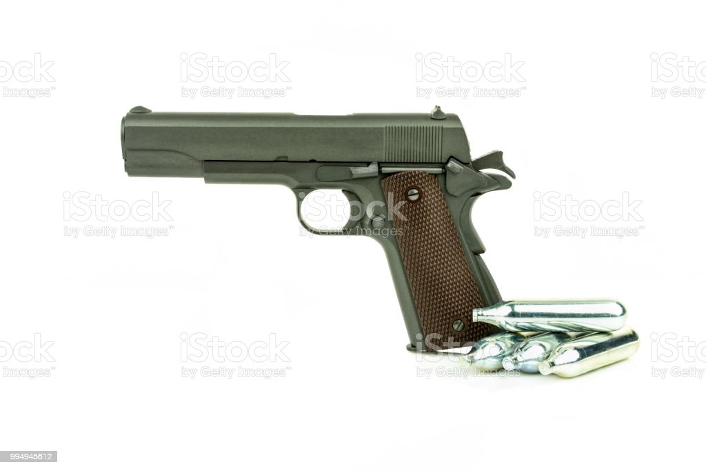 Profile view of isolated semi-automatic airsoft handgun with gas container. Replica of real handgun on white background. stock photo