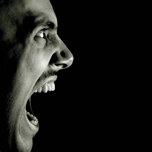 Profile View of Man Screaming, Black and White stock photo
