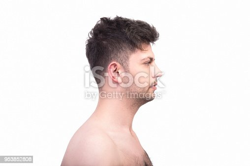 istock Profile view of naked young man looking away with blank facial expression on a white background 953852808