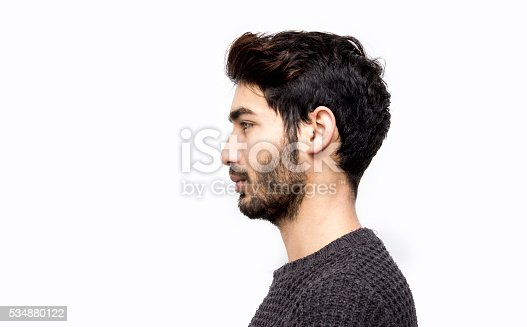 istock Profile view of serious young man over white background 534880122