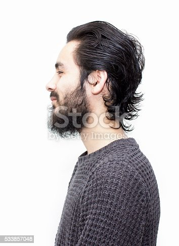 istock Profile view of smiling young man over white background 533857048