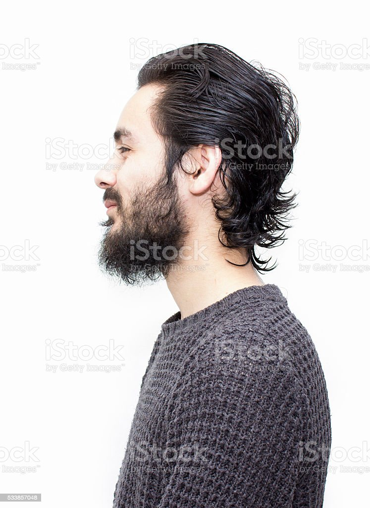 Profile view of smiling young man over white background stock photo