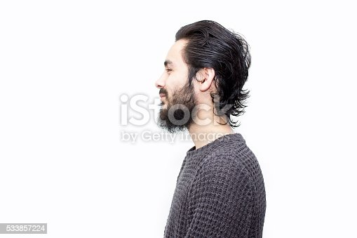 istock Profile view of smiling young man over white background 533857224