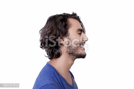 istock Profile view of smiling young man 1024127510
