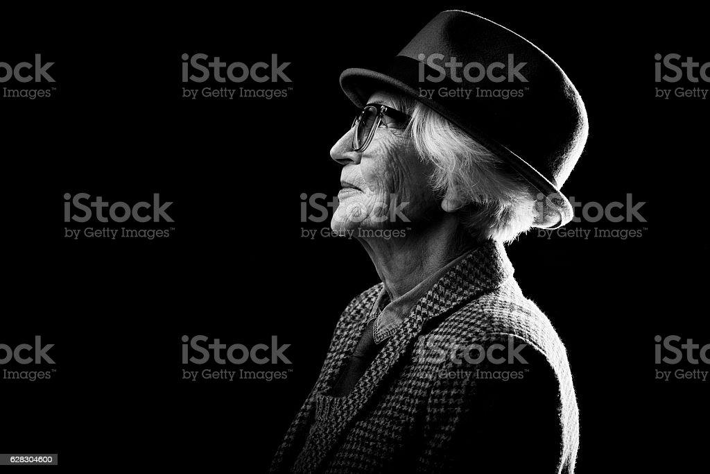 Profile view of stylish senior woman stock photo