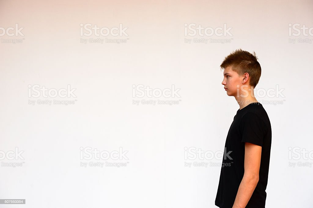 Profile view of teenager boy outdoors stock photo