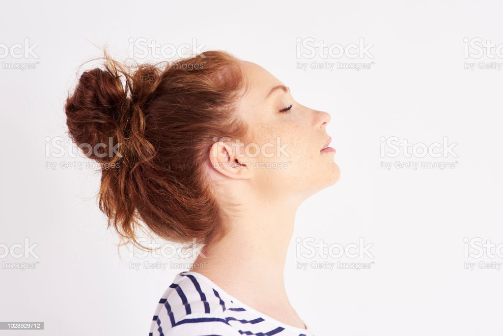 Profile view of woman's face at studio shot stock photo