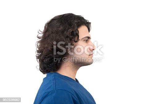 istock Profile view of young man looking away with blank facial expression on a white background 952338662