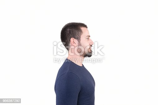 istock Profile view of young man looking away with blank facial expression on a white background 956387292