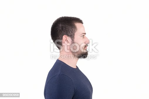 istock Profile view of young man looking away with blank facial expression on a white background 956390958
