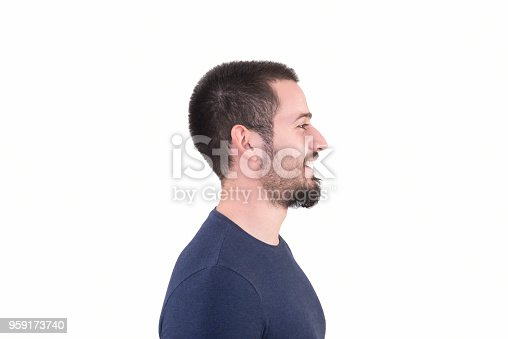 istock Profile view of young man looking away with content smile on a white background 959173740