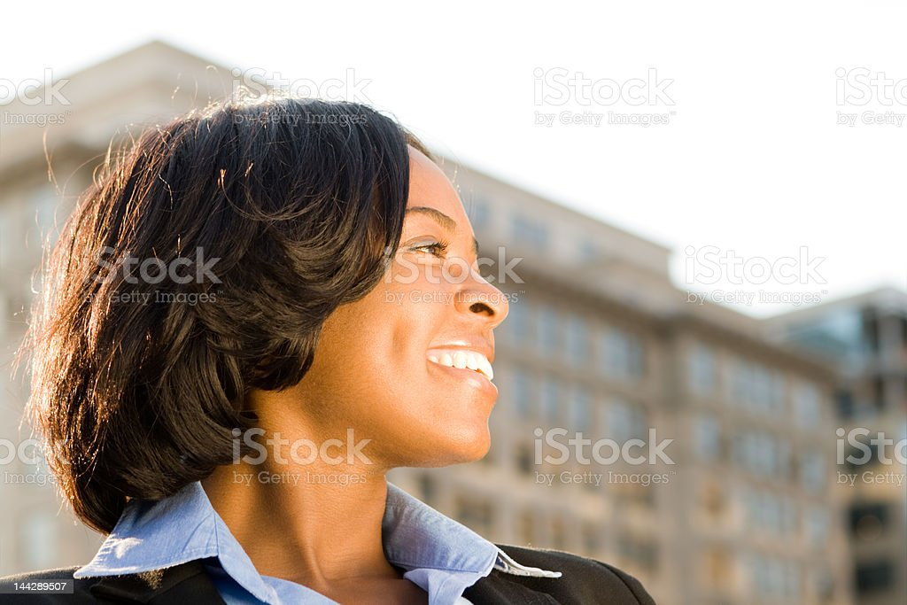 Profile Young Smiling African American Woman Building Background stock photo