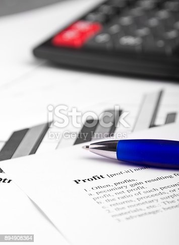 851244800istockphoto Profit definition with pen and calculator aside 894908364