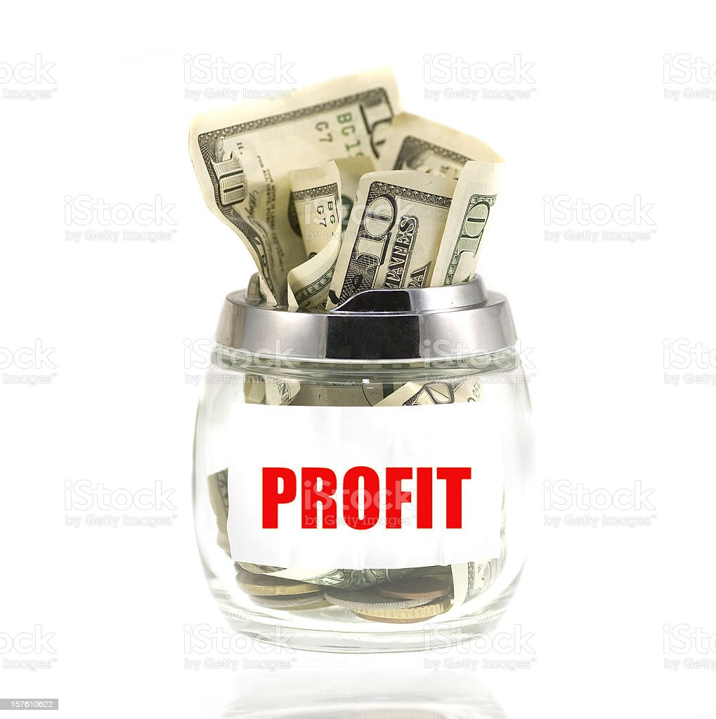 profit dollars in piggybank glass royalty-free stock photo