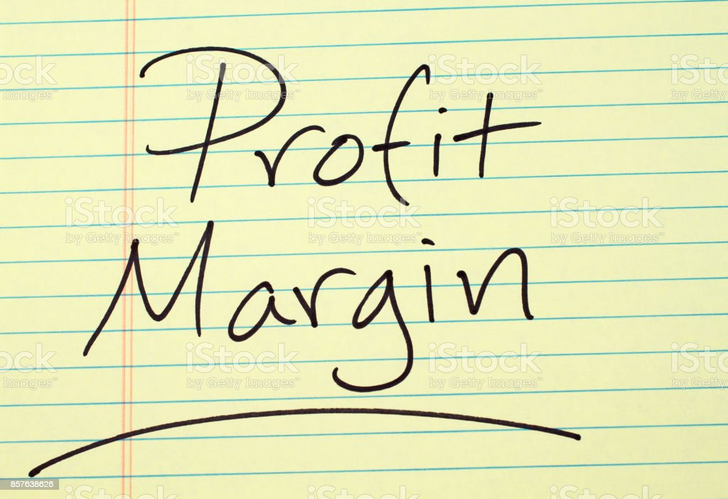 Profit Margin On A Yellow Legal Pad stock photo