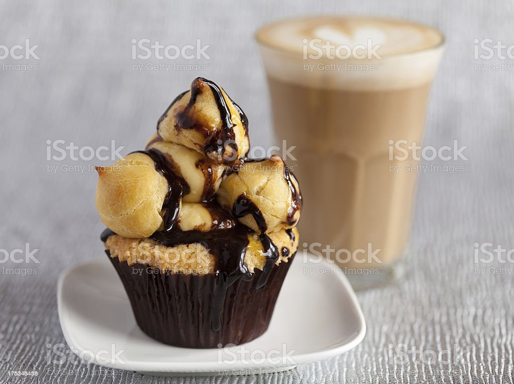 Profiterole Cupcake with Cafe Latte royalty-free stock photo