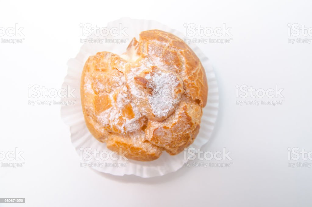 Profiteroles stuffed with pastry cream on white desk in cafe stock photo