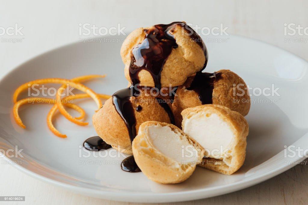 profiteroles with chocolate glaze stock photo