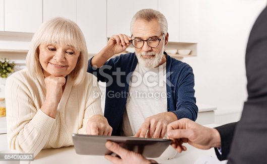 istock Profound real estate agent demonstrating house project to the clients 654090362