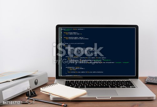 istock program code on computer screen. Programming and coding technology background 847151712
