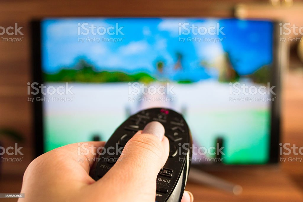 Program switching or button pressing on TV remote control stock photo