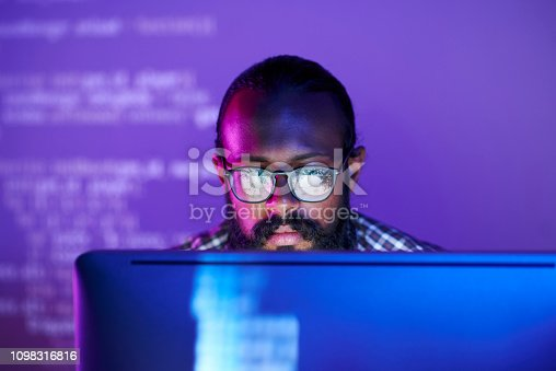 1098316816 istock photo Programmer in front of monitor 1098316816