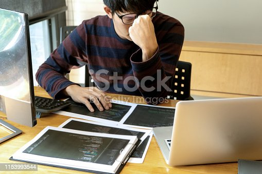 programmer work with Developing programming and coding try to solve the problem so serious and sometime feel  headache or sad