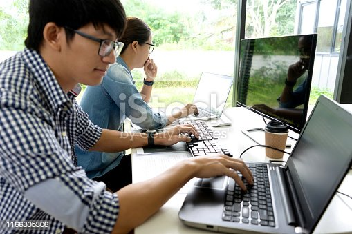 1170082011 istock photo programmer work with Developing programming 1166305306