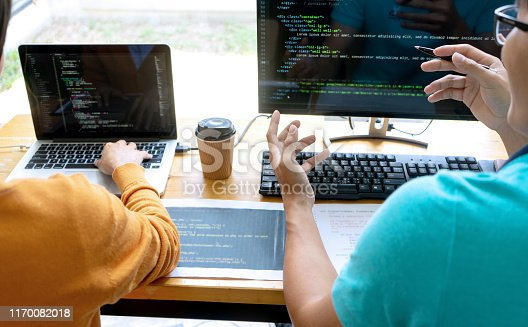 1170082011 istock photo programmer work with Developing programming 1170082018