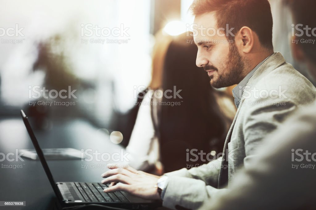 Programmer working and developing software  in office on laptop stock photo