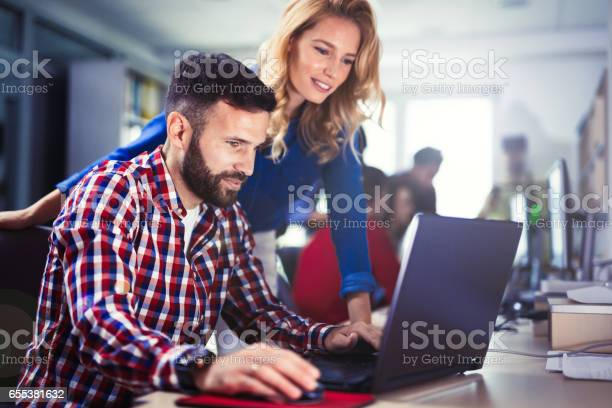 Programmer Working In A Software Developing Company Office Stock Photo - Download Image Now