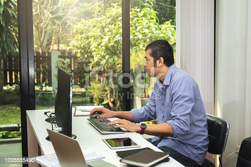 1170085960 istock photo Programmer working in a software developing. Developing programming and coding technologies. Website design. Cyber space concept. 1205555490