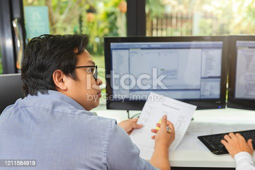 1170085960 istock photo Programmer working in a software developing. Developing programming and coding technologies. Website design. Cyber space concept. 1211584919