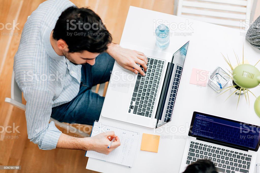 Programmer working in his office stock photo