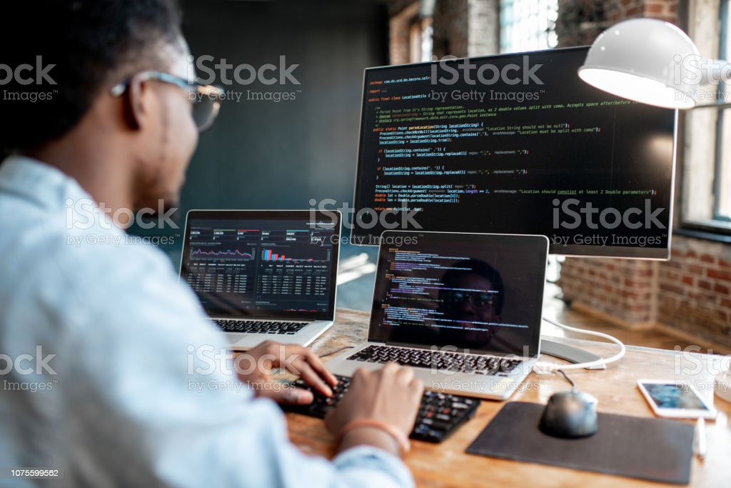 Programmer working with program code - Royalty-free Adult Stock Photo