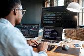 istock Programmer working with program code 1075599562