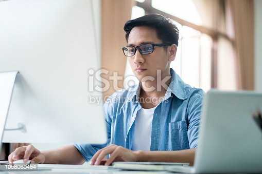 844472230 istock photo Programmers and developer teams are coding and developing software 1058060454