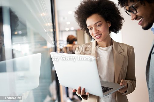 istock Programmers cooperating at IT company developing apps 1175650256