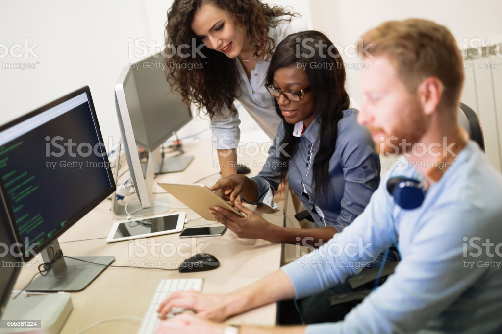 Programmers cooperating at  IT company developing apps royalty-free stock photo