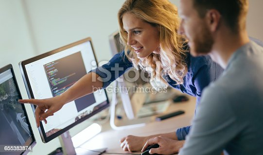 istock Programmers cooperating at  IT company developing apps 655383874