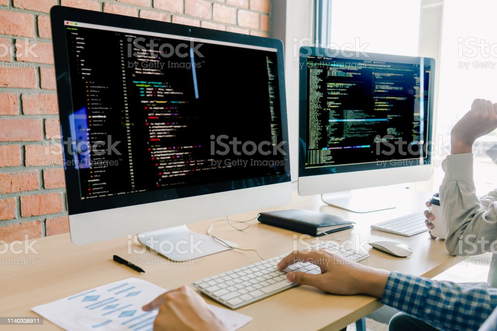 programming and coding technologies. Website design. Programmer working business in software develop company office screen computer background programming and coding technologies. Website design. Programmer working business in software develop company office screen computer background Analyzing Stock Photo