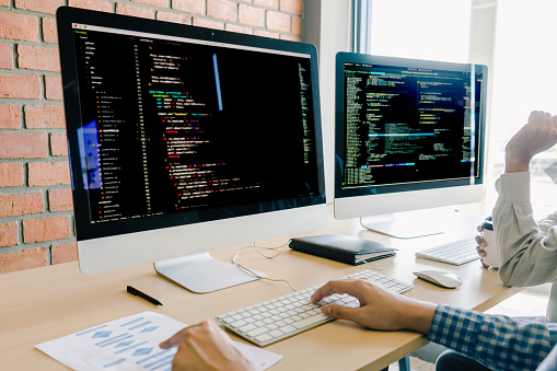 Programming And Coding Technologies Website Design Programmer Working Business In Software Develop Company Office Screen Computer Background Stock Photo - Download Image Now