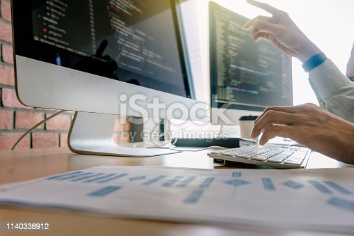 istock programming and coding technologies. Website design. Programmer working business in software develop company office screen computer background 1140338912