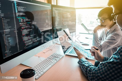 1210151924 istock photo programming and coding technologies. Website design. Programmer working business in software develop company office screen computer background 1140338915