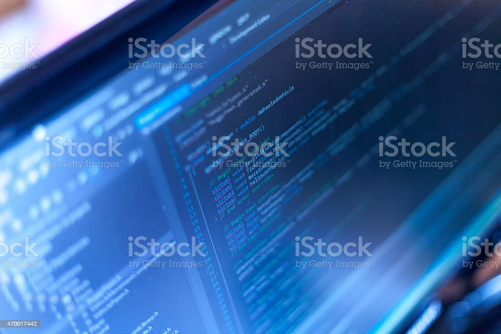 Programming code on a monitor. stock photo
