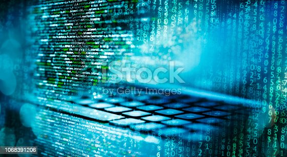 istock Programming code with computer and matrix 1068391206