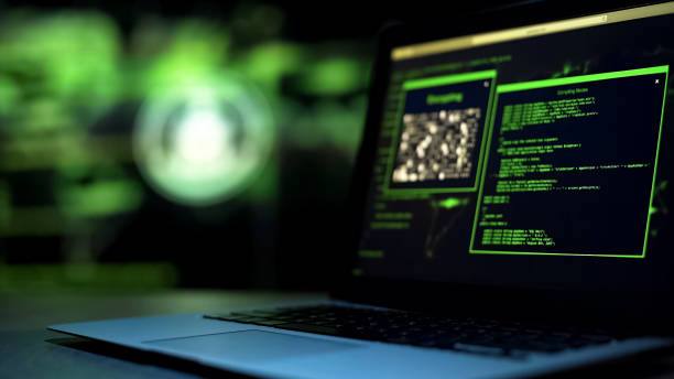 Programming scripts on laptop monitor, unauthorized remote hacking of server Programming scripts on laptop monitor, unauthorized remote hacking of server spyware stock pictures, royalty-free photos & images