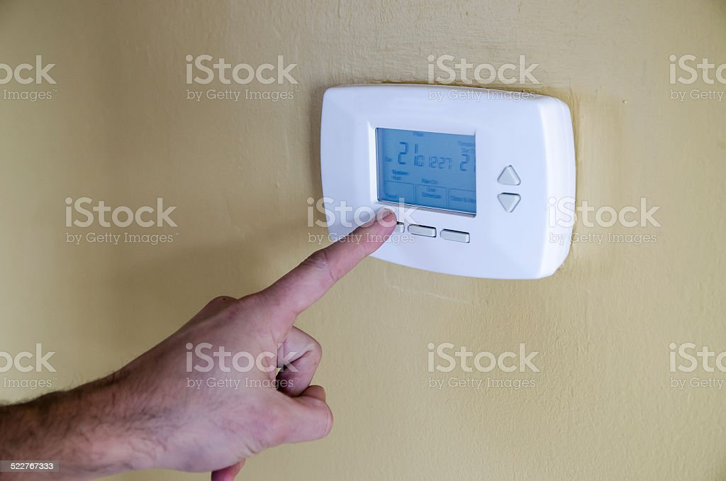 Programming thermostat stock photo
